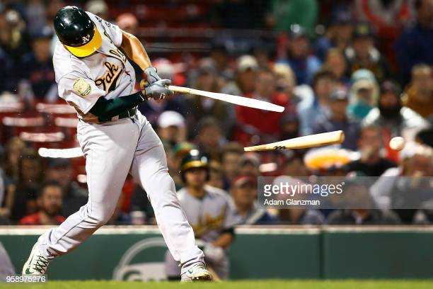 Marcus Semien of the Oakland Athletics breaks his bat on a ground ball to third base in the fifth inning of a game against the Boston Red Sox at...