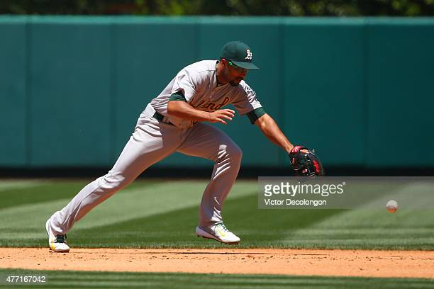 Marcus Semien of the Oakland Athletics can't handle a ground ball to shortstop in the fourth inning during the MLB game against the Los Angeles...