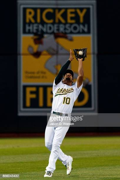Marcus Semien of the Oakland Athletics catches a fly ball against the Seattle Mariners during the first inning at the Oakland Coliseum on September...
