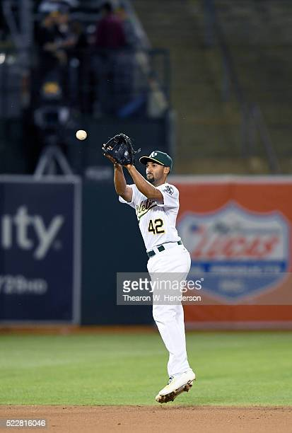 Marcus Semien of the Oakland Athletics catches a line drive off the bat of Alcides Escobar of the Kansas City Royals in the top of the fourth inning...