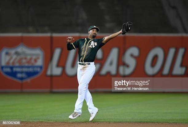 Marcus Semien of the Oakland Athletics catches a line drive off the bat of Adrian Beltre of the Texas Rangers in the top of the eighth inning at...