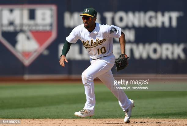 Marcus Semien of the Oakland Athletics charges a ground ball off the bat of Tyler White of the Houston Astros in the top of the six inning at Oakland...