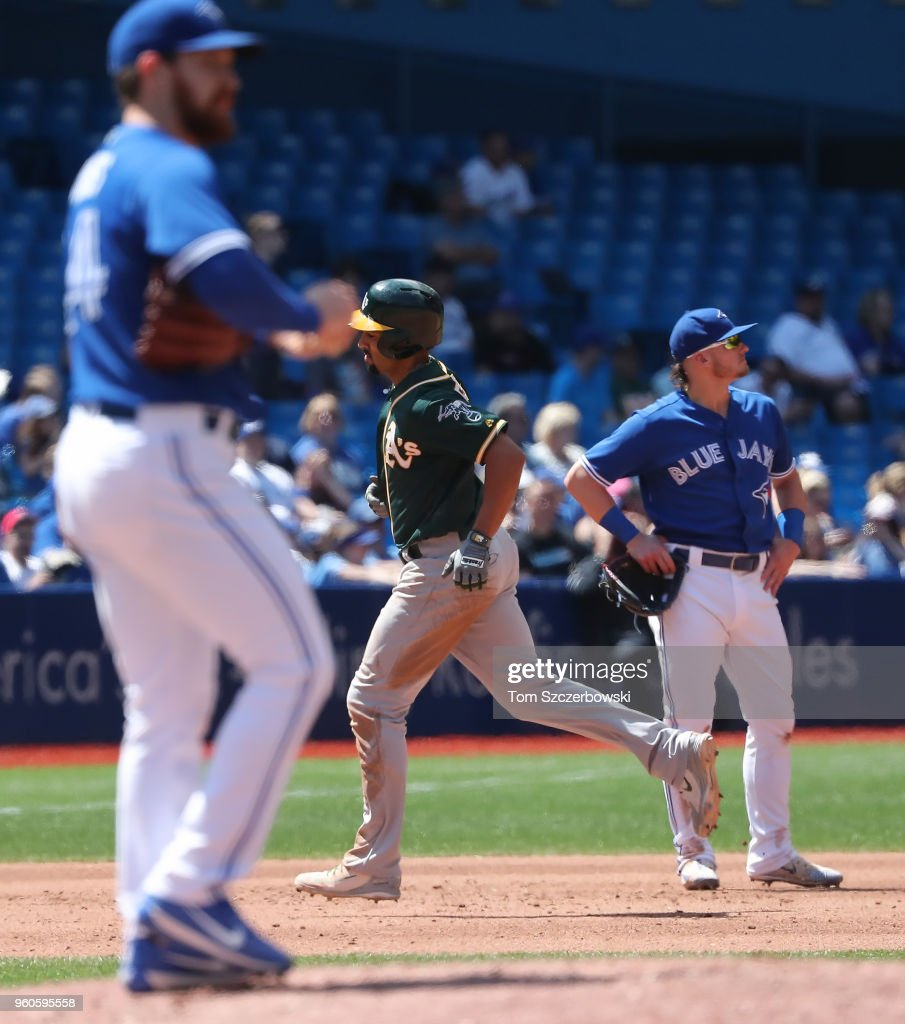 Marcus Semien #10 of the Oakland Athletics circles the bases after hitting a two-run home run in the fifth inning during MLB game action as Danny Barnes #24 of the Toronto Blue Jays reacts on the mound at Rogers Centre on May 20, 2018 in Toronto, Canada.