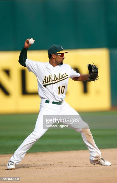 Marcus Semien of the Oakland Athletics fields during the game against the Los Angeles Angels of Anaheim at the Oakland Alameda Coliseum on September...