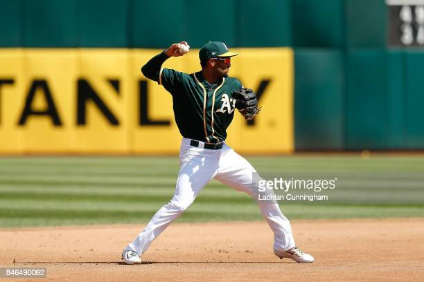 Marcus Semien of the Oakland Athletics fields the ball at shortstop and throws to first base to get the out of Alex Bregman of the Houston Astros in...