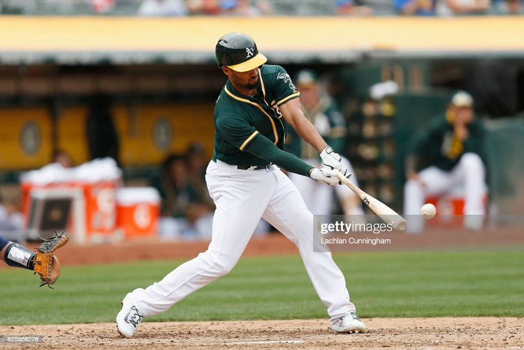 Marcus Semien #10 of the Oakland Athletics hits a double in the seventh inning against the Seattle Mariners at Oakland Alameda Coliseum on August 9, 2017 in Oakland, California.