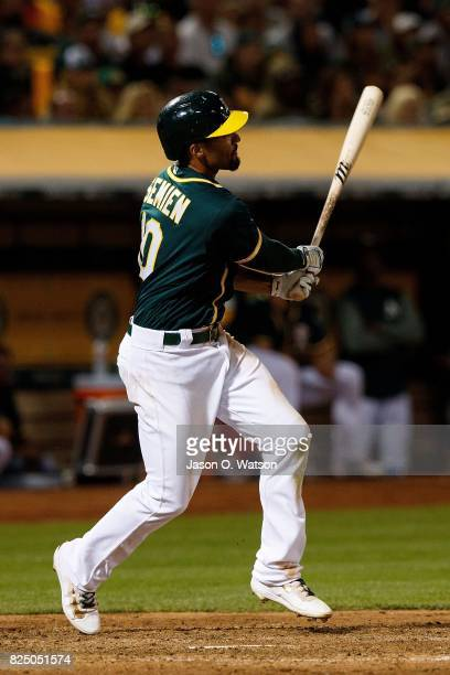Marcus Semien of the Oakland Athletics hits a grand slam home run against the San Francisco Giants during the sixth inning at the Oakland Coliseum on...