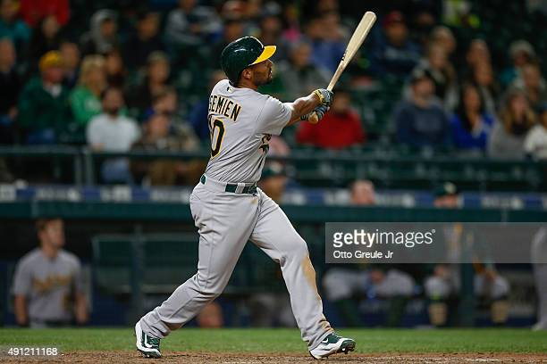Marcus Semien of the Oakland Athletics hits a tworun home run against the Seattle Mariners in the thirteenth inning at Safeco Field on October 3 2015...