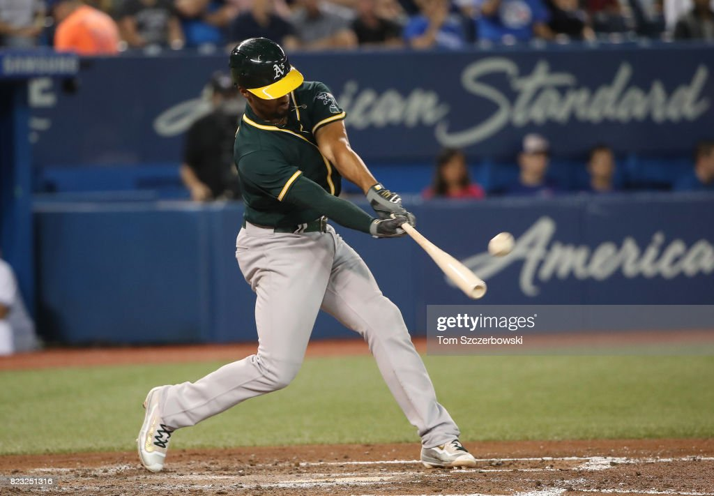 Marcus Semien #10 of the Oakland Athletics hits a two-run home run in the fifth inning during MLB game action against the Toronto Blue Jays at Rogers Centre on July 26, 2017 in Toronto, Canada.