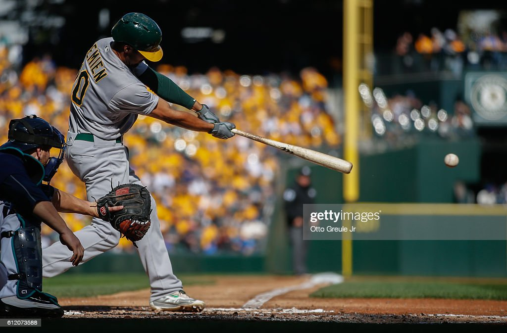 Marcus Semien #10 of the Oakland Athletics hits an RBI single in the third inning against the Seattle Mariners at Safeco Field on October 2, 2016 in Seattle, Washington. The Athletics defeated the Mariners 3-2.
