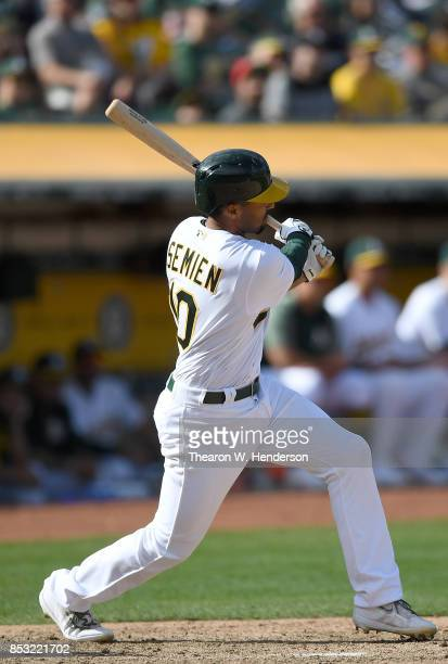 Marcus Semien of the Oakland Athletics hits an rbi single scoring Josh Phegley against the Texas Rangers in the bottom of the eighth inning at...