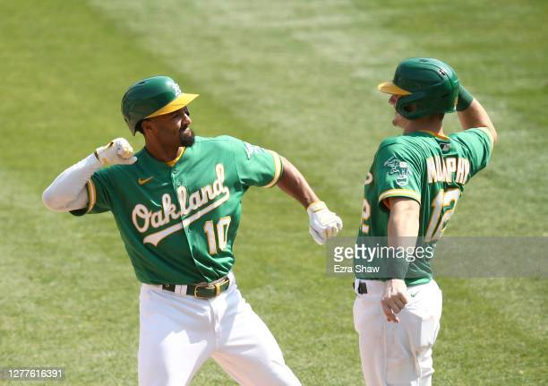 Marcus Semien of the Oakland Athletics is congratulated by Sean Murphy after he hit a two-run home run against the Chicago White Sox in the second...