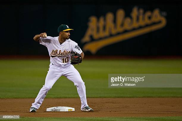 Marcus Semien of the Oakland Athletics is unable to complete a double play against the San Francisco Giants during the first inning at Oco Coliseum...