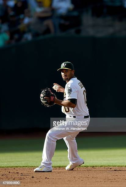 Marcus Semien of the Oakland Athletics looks to throw out Mark Trumbo of the Seattle Mariners in the top of the second inning at Oco Coliseum on July...