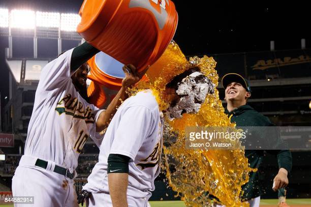 Marcus Semien of the Oakland Athletics pours Gatorade on Jed Lowrie after he hit a walk off single during the ninth inning against the Houston Astros...