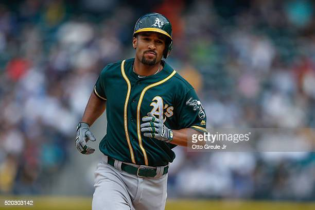 Marcus Semien of the Oakland Athletics rounds the bases after hitting a solo home run in the eighth inning against the Seattle Mariners at Safeco...