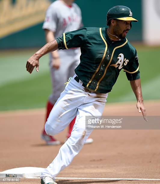 Marcus Semien of the Oakland Athletics rounds third base to score on an rbi double from Stephen Vogt against the Los Angeles Angels of Anaheim in the...