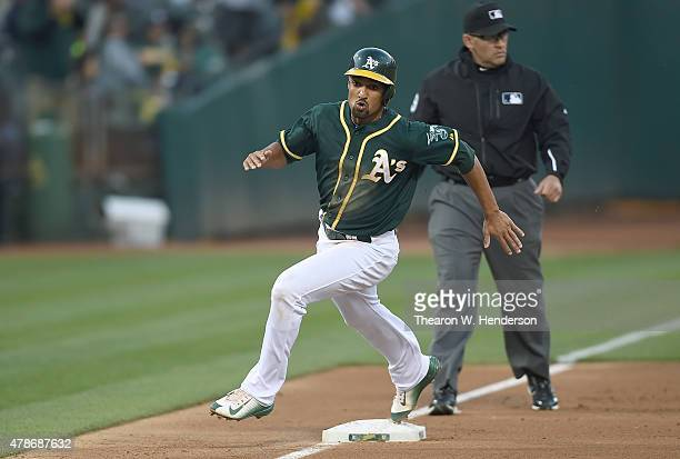 Marcus Semien of the Oakland Athletics rounds third base to score on an rbi double from Sam Fuld against the Kansas City Royals in the bottom of the...