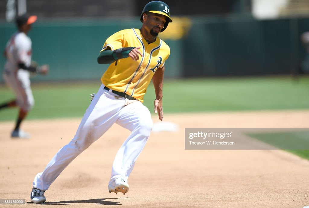 Marcus Semien #10 of the Oakland Athletics rounds third base to score on a rbi double from Ryon Healy #25 against the Baltimore Orioles in the bottom of the fourth inning at Oakland Alameda Coliseum on August 13, 2017 in Oakland, California.