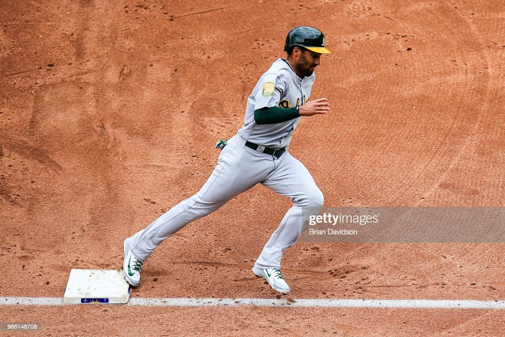 Marcus Semien #10 of the Oakland Athletics runs past third and towards home for a run against the Kansas City Royals during the third inning at Kauffman Stadium on June 2, 2018 in Kansas City, Missouri.