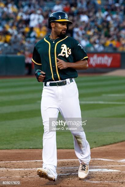 Marcus Semien of the Oakland Athletics scores a run against the San Francisco Giants during the first inning at the Oakland Coliseum on July 31 2017...