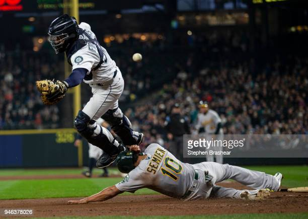 Marcus Semien of the Oakland Athletics scores as catcher cannot get to a throw at the plate on a tworun single by Mark Canha of the Oakland Athletics...