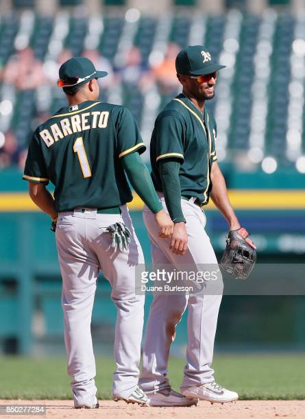 Marcus Semien of the Oakland Athletics smiles while chatting with Franklin Barreto of the Oakland Athletics following the Athletics 32 win over the...