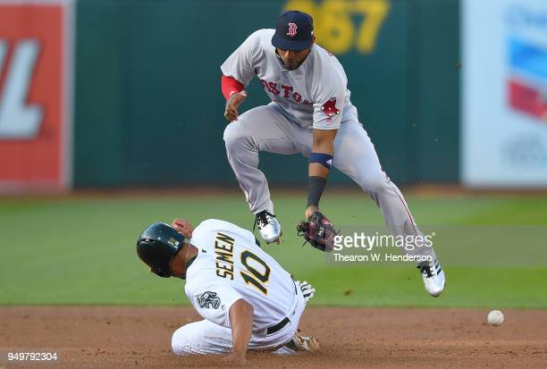 Marcus Semien of the Oakland Athletics steals second base beating the throw down to Eduardo Nunez of the Boston Red Sox in the bottom of the first...