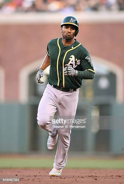 Marcus Semien of the Oakland Athletics trots around the bases after hitting a threerun homer against the San Francisco Giants in the top of the...