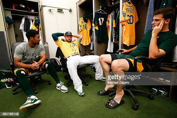 Marcus Semien Yonder Alonso and Andrew Triggs of the Oakland Athletics relax in the clubhouse prior to the game against the Los Angeles Angels of...