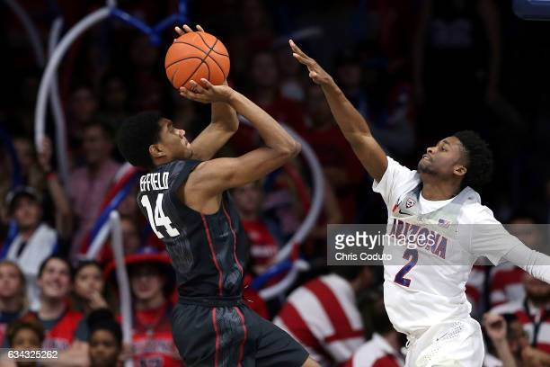 Marcus Sheffield of the Stanford Cardinal shoots over Kobi Simmons of the Arizona Wildcats during the second half of the college basketball game at...