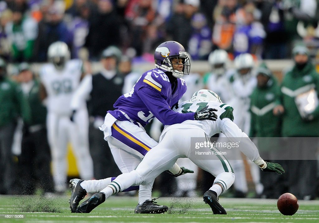 Marcus Sherels #35 of the Minnesota Vikings and Jeremy Kerley #11 of the New York Jets go after a loose ball after Kerley dropped a punt during the fourth quarter of the game on December 7, 2014 at TCF Bank Stadium in Minneapolis, Minnesota. The Vikings defeated the Jets 30-24.