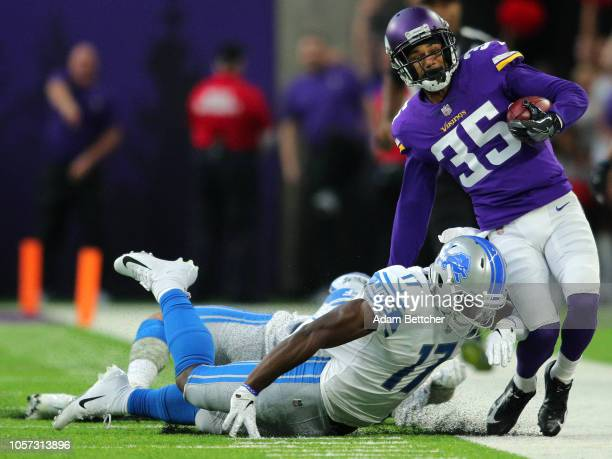 Marcus Sherels of the Minnesota Vikings is forced out of bounds with the ball by Andy Jones of the Detroit Lions in the first half of the game at US...