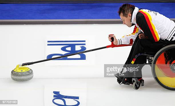 Marcus Sieger releases the stone during the Wheelchair Curling Round Robin game between Germany and the United States on day three of the 2010...