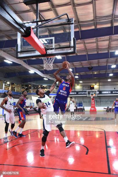 Marcus Simmons of the Grand Rapids Drive shoots the ball against the Iowa Wolves NBA G League Showcase Game 20 between the Grand Rapids Drive and the...