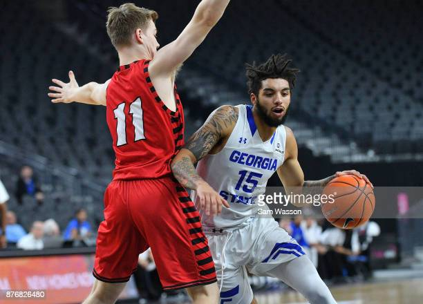 Marcus Simonds of the Georgia State Panthers drives against Jack Perry of the Eastern Washington Eagles during day one of the Main Event basketball...