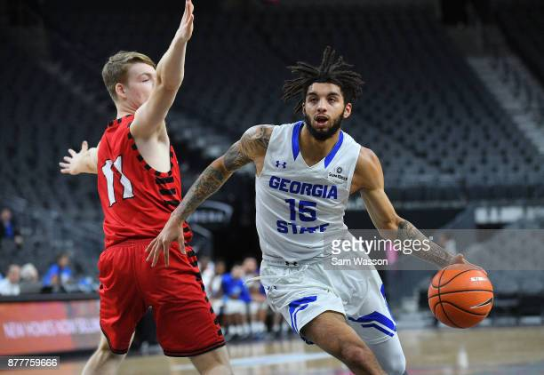 Marcus Simonds of the Georgia State Panthers drives past Jack Perry of the Eastern Washington Eagles during day one of the Main Event basketball...