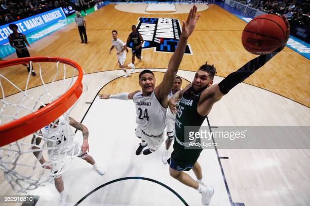 Marcus Simonds of the Georgia State Panthers goes up for a dunk over Kyle Washington of the Cincinnati Bearcats during the game in the first round of...