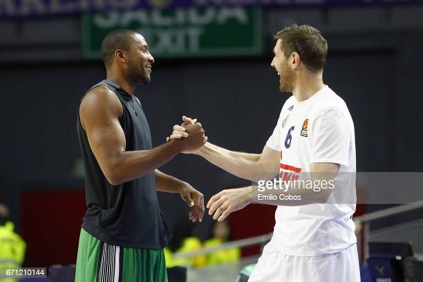 Marcus Slaughter #44 of Darussafaka Dogus Istanbul salutes Andres Nocioni #6 of Real Madrid before the game during the 2016/2017 Turkish Airlines...