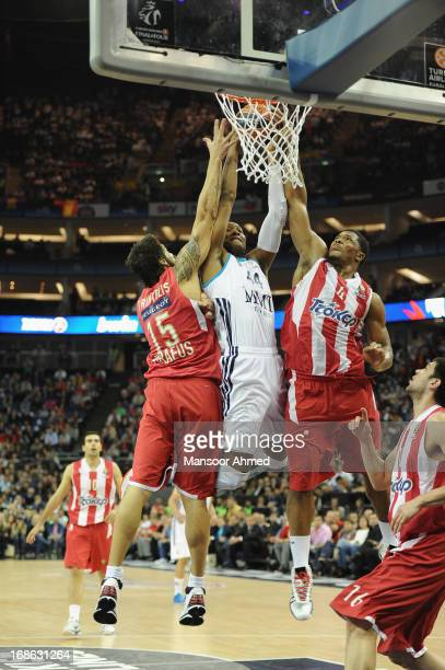Marcus Slaughter #44 of Real Madrid competes with Kyle Hines#4 and Georgios Printezis #15 of Olympiacos Piraeus during the Turkish Airlines...