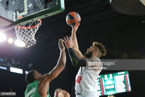 Marcus Slaughter of Darussafaka Dogus in action against Jeffery Taylor of Real Madrid during the Turkish Airlines EuroLeague Playoffs Game 4 between...