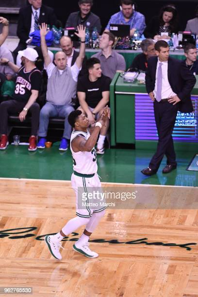 Marcus Smart and Head Coach Brad Stevens of the Boston Celtics react during the game against of the Cleveland Cavaliers on Game Five of the 2018 NBA...