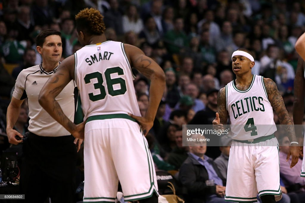 Marcus Smart #36 and Isaiah Thomas #4 of the Boston Celtics speak to referee Ben Taylor #46 after a foul call against Thomas in the third quarter against the Charlotte Hornets at TD Garden on April 11, 2016 in Boston, Massachusetts.