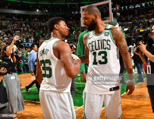 Marcus Smart and Marcus Morris of the Boston Celtics exchange handshakes during Game Two of the Eastern Conference Finals against the Cleveland...