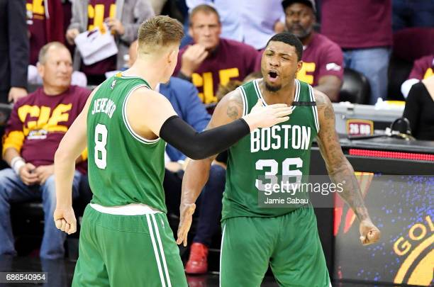 Marcus Smart celebrates with Jonas Jerebko of the Boston Celtics after their 111 to 108 win over the Cleveland Cavaliers during Game Three of the...
