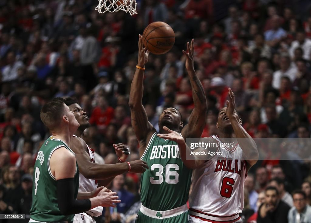 Marcus Smart (36) of Celtics attempts to score against Bulls during the NBA match between Chicago Bulls and Boston Celtics at the United Center in Chicago, Illinois, United States on April 23, 2017.