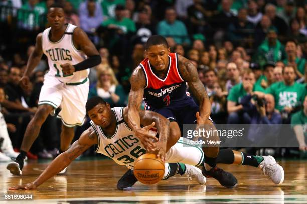Marcus Smart of the Boston Celtics and Bradley Beal of the Washington Wizards battle for a loose ball during the second half of Game Five of the...