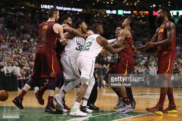 Marcus Smart of the Boston Celtics and JR Smith of the Cleveland Cavaliers get into an altercation in the second half during Game Two of the 2018 NBA...