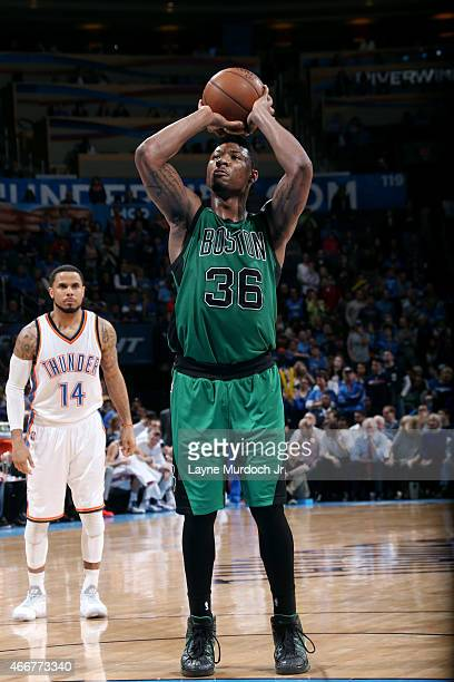 Marcus Smart of the Boston Celtics attempts a free throw against the Oklahoma City Thunder on March 18 2015 at the Chesapeake Energy Arena in...