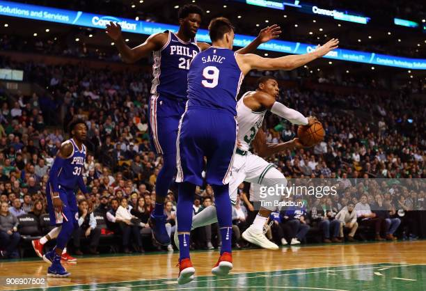 Marcus Smart of the Boston Celtics attempts to pass the ball during the first half against the Philadelphia 76ers at TD Garden on January 18 2018 in...